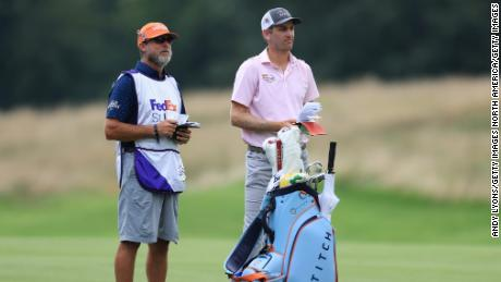 Todd talks with his caddie on the seventh hole during the final round of the World Golf Championship-FedEx St Jude Invitational.