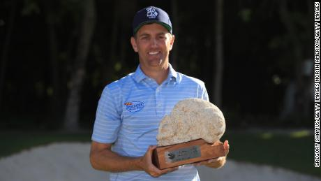 Todd celebrates with the trophy after winning the Mayakoba Golf Classic at El Camaleon Mayakoba Golf Course.