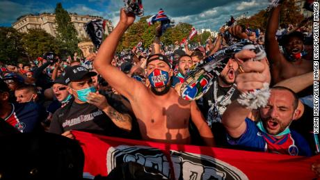 PSG fans chant near the Parc de Princes Stadium as they prepare to watch their team play.