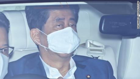 Japan's Prime Minister Shinzo Abe wearing a face mask arrives at Keio University Hospital for a clinical examination in Shinjuku Ward, Tokyo on August 24, 2020, amid continuing worries over the new coronavirus COVID-19. Abe's term as Prime Minister has reached 2799 days, the longest continuous incumbency in constitutional history. Abe's term of office will be until the end of September in 2021. ( The Yomiuri Shimbun via AP Images )