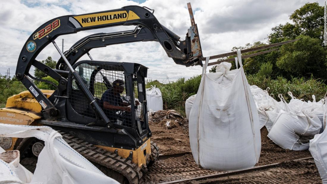 Crews bring sandbags to help with flooding prevention in Belle Chasse, Louisiana.
