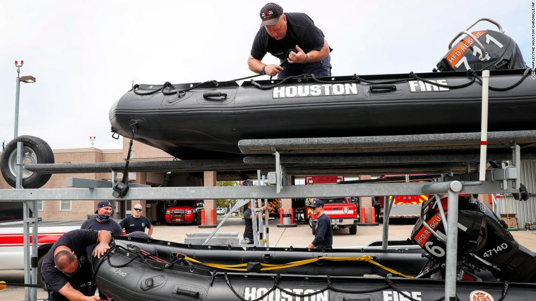 Houston firefighters prepare rescue equipment in advance of the storm.