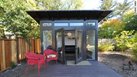 Rather than buying a new house for home office space, some remote workers are adding backyard sheds like this one by Studio Shed.