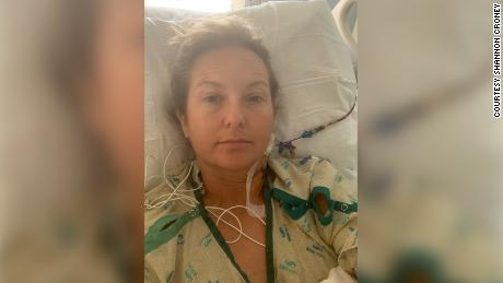 Shannon Croney, seen here in the hospital, said she is feeling better than she has in years.
