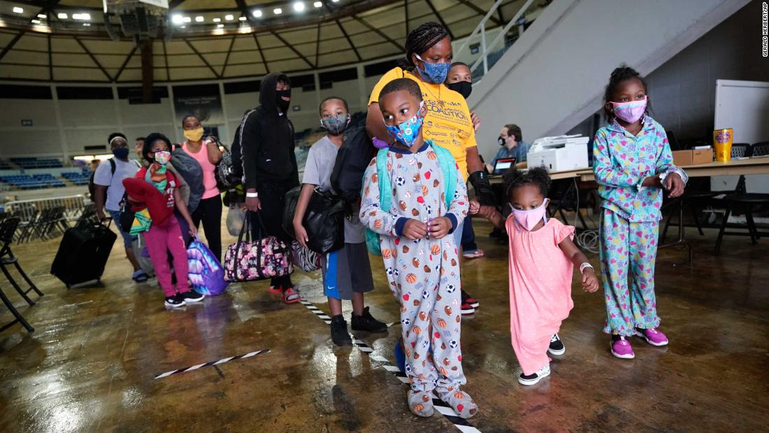 Victoria Nelson lines up her children, Autum, Shawn and Asia, as they board a bus to evacuate Lake Charles on August 26.
