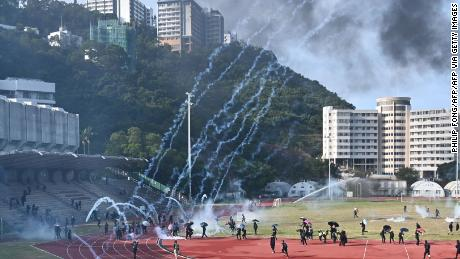 Protesters react after police fired tear gas at the Chinese University of Hong Kong (CUHK) campus on November 12, 2019.