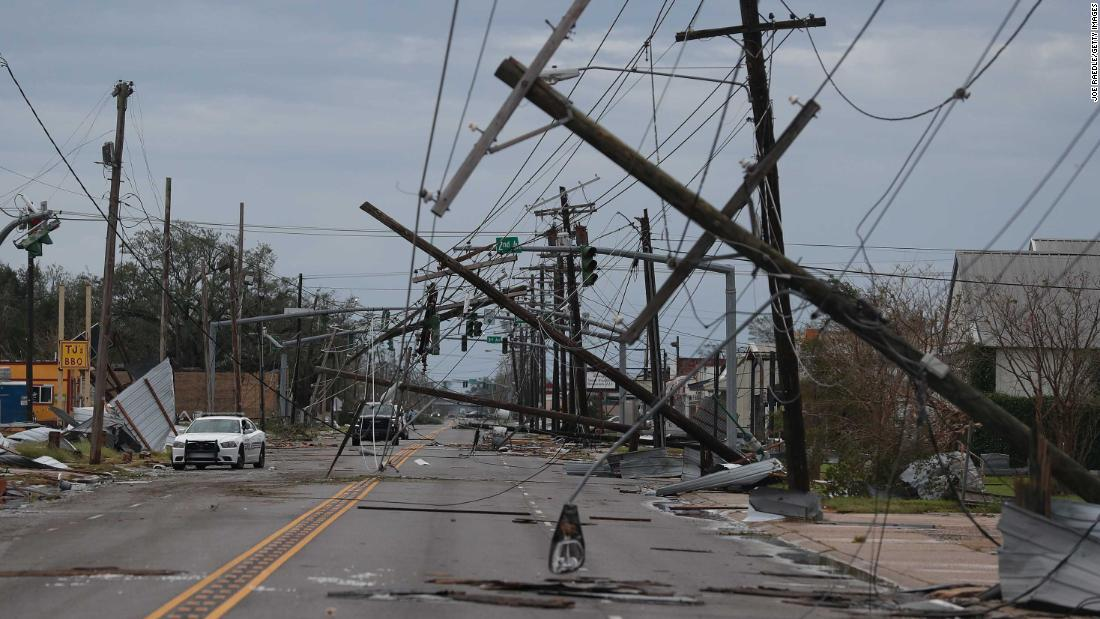 A tangle of power lines hangs over a street in Lake Charles.