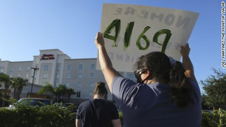 Protesters wave signs in front of the Hampton Inn hotel in McAllen, Texas, on July 23rd.