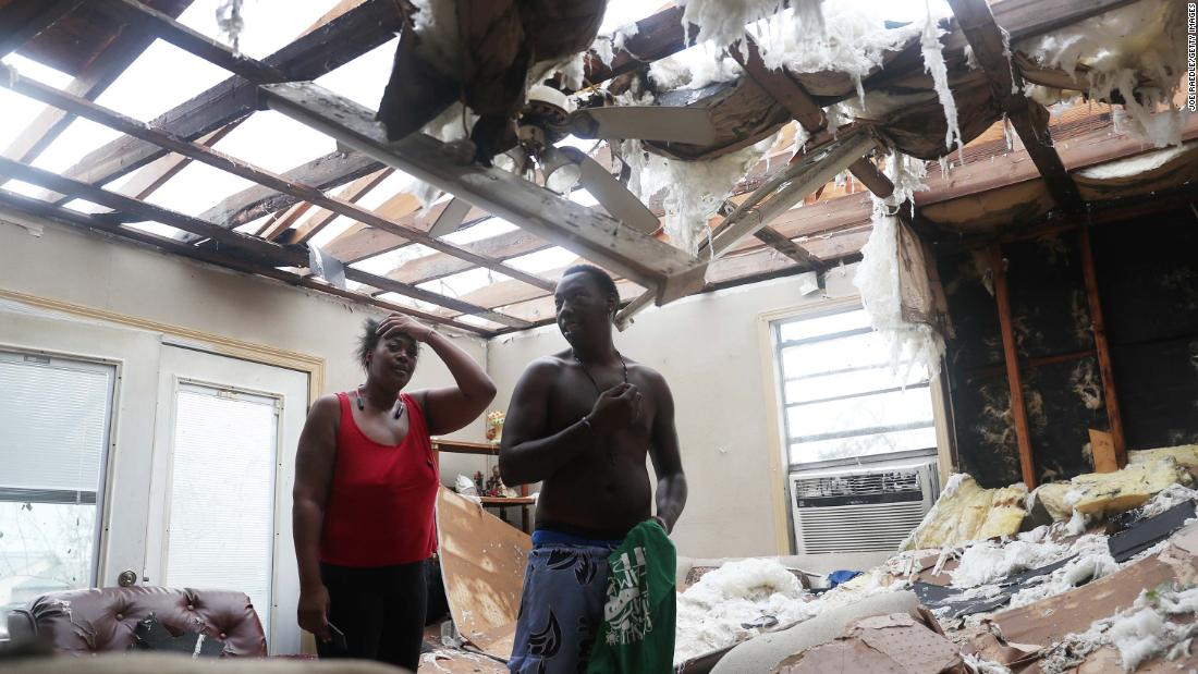 Latasha Myles and Howard Anderson stand in their Lake Charles living room, which is where they were sitting when the roof blew off around 2:30 a.m. in agosto 27.