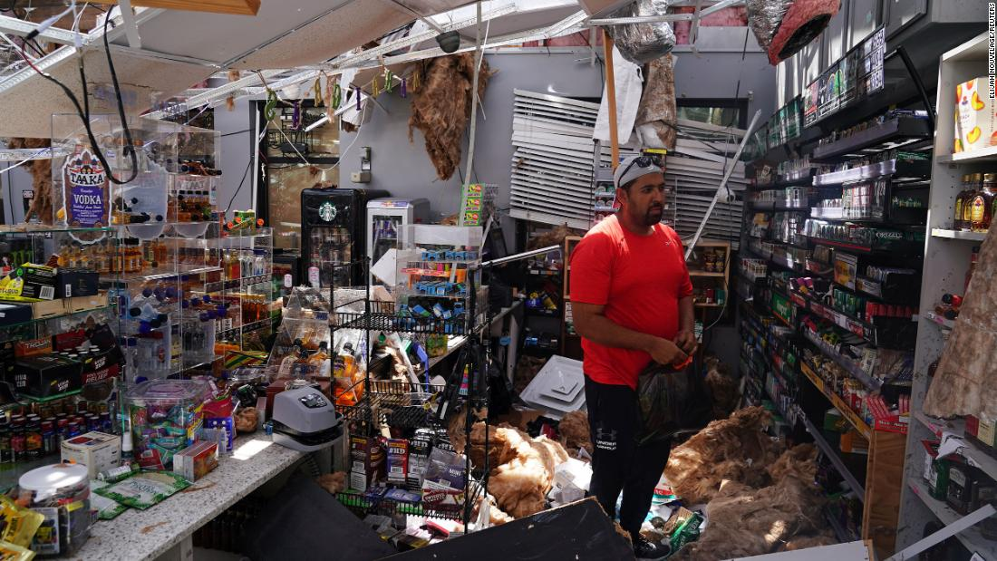 Ahmed Nawaz looks at the damage in his store in Lake Charles on August 27.