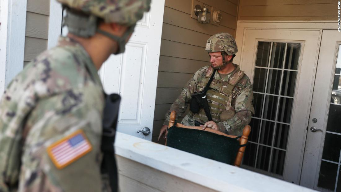 Louisiana National Guard Pfc. Devin Lejeune helps search a Lake Charles apartment complex for people in need.
