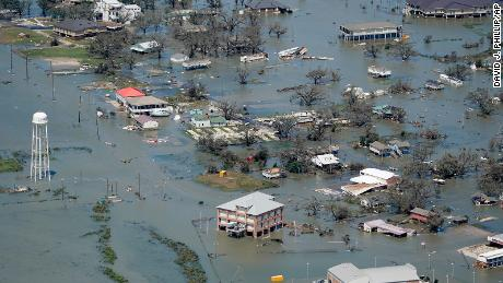 Buildings and homes are flooded in the aftermath of Hurricane Laura Thursday, Aug. 27, 2020, near Lake Charles, La. (AP Photo/David J. Phillip)