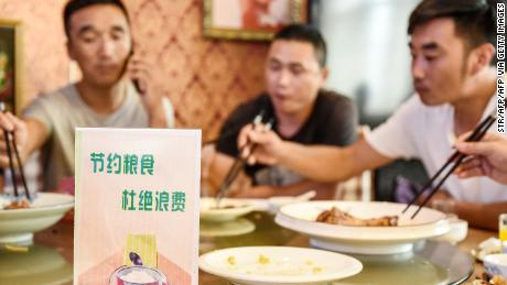 A sign encouraging people not to waste food is seen at a restaurant in Handan in China's northern Hebei province on August 13.