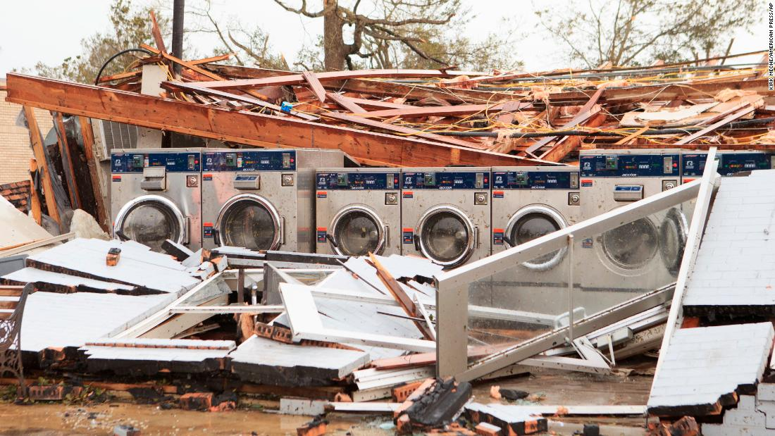 Pousson's Laundromat and Barbershop is left in ruins in Westlake, Louisiana.