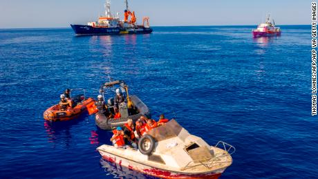 "The pink rescue boat ""Louise Michel"" (back R) is pictured off the Libyan coast on August 22, 2020."