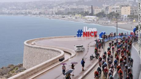 The Tour de France peloton competes on rain soaked roads in Nice at the start of the 107th Tour de France on a stage littered with crashes in treacherous conditions.