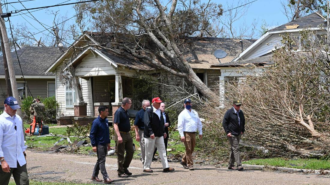 President Donald Trump tours the damage in Lake Charles on August 29.