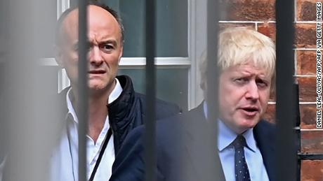 Boris Johnson and Cummings leave from the rear of Downing Street on September 3, 2019, before heading to the Houses of Parliament.