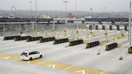 A vehicle drives towards Mexico near the San Ysidro port of entry in San Diego, California, US, on Tuesday, Aug. 25, 2020.