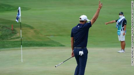 Johnson celebrates making his putt for birdie on the 18th hole to force a playoff at the BMW Championship.