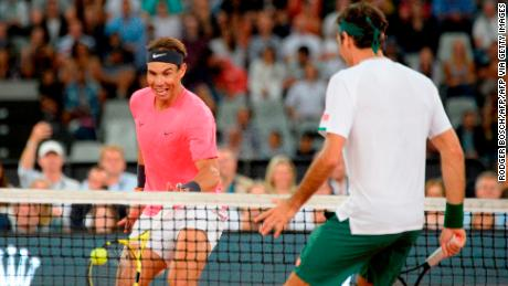 Nadal (left) and Federer will not compete at this year's US Open.