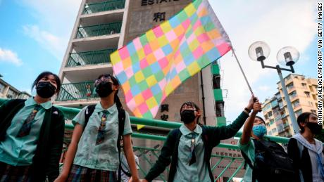 High school students join hands to form a protest chain in the Kwun Tong area of Kowloon in Hong Kong on September 24, 2019.
