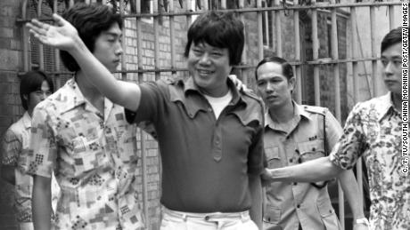 Ma Sik-chun is escorted to court to face charges of drug trafficking. Ma was the publisher and Chairman of the Oriental Daily News.