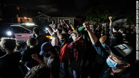 Protesters gather in front of Los Angeles County Sheriff's deputies on Monday night.