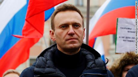 Russian opposition leader Alexey Navalny is out of a coma, hospital says