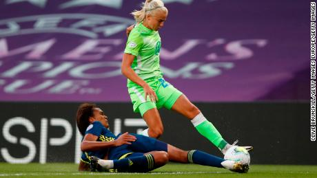 Harder is talked by Wendie Renard of Lyon during the UEFA Women's Champions League Final.