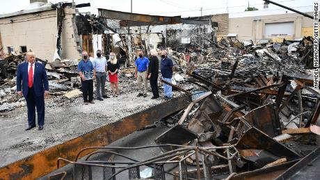 President Donald Trump tours an area affected by civil unrest in Kenosha on September 1.