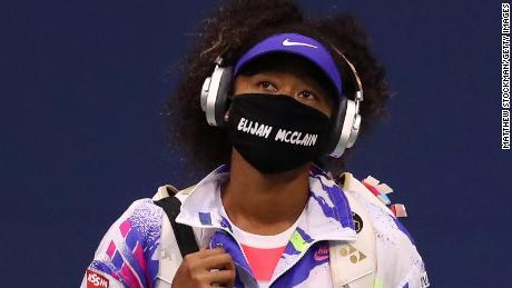 Osaka arrives on court with Elijah McClain's name on a face mask.