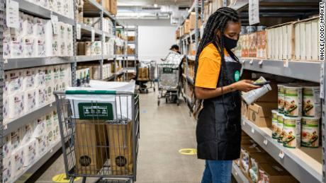 Whole Foods workers stock and pick items off shelves in the store and then Amazon drivers deliver them to customers in the Brooklyn area.