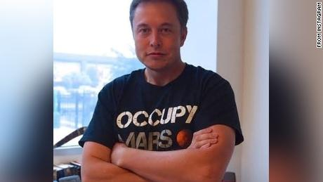 """Musk, in a photo posted to his Instagram, wears one of SpaceX's """"Occupy Mars"""" t-shirts."""
