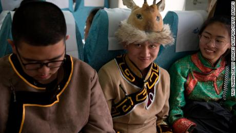 Students in traditional clothing travel on a special train to attend university entrance exam in Inner Mongolia, China in June, 2019.