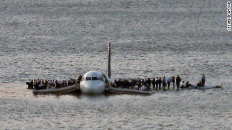 Passengers wait to be rescued on the wings of Flight 1549 after it landed in 2009 in the Hudson River.