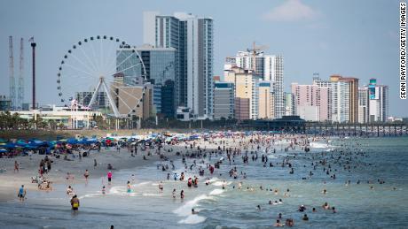 People enjoy the beach on Saturday in Myrtle Beach, South Carolina.