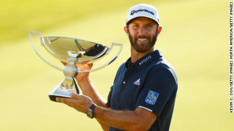 Dustin Johnson holds the FedEx Cup aloft following his Tour Championship win.