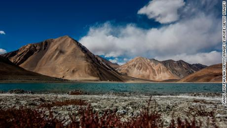 Mountains rise over the Pangong Tso Lake on October 5, 2012 near Leh in Ladakh, India.