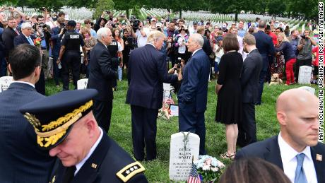 President Donald Trump with John Kelly on Memorial Day at Arlington National Cemetery on Monday May 29, 2017.