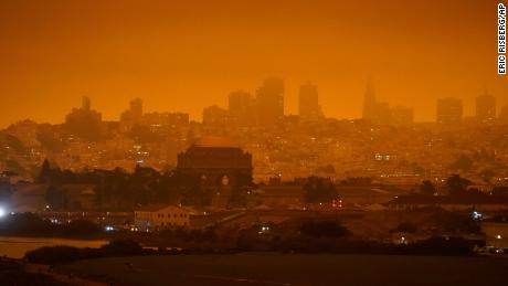 The skyline in the distance behind Crissy Field is barely visible with smoke from wildfires Wednesday, Sept. 9, 2020, in San Francisco. (AP Photo/Eric Risberg)