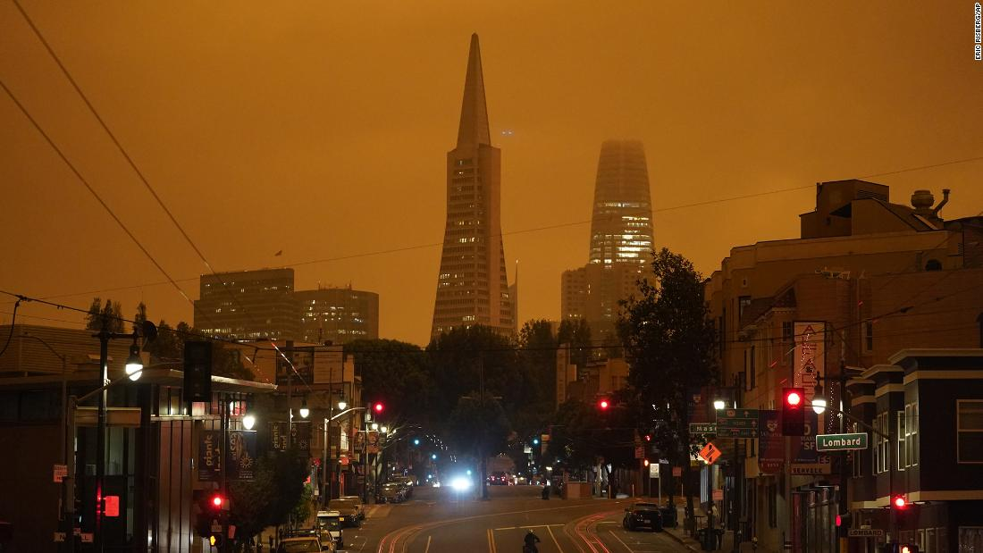 Looking up San Francisco's Columbus Avenue, the Transamerica Pyramid and Salesforce Tower are covered with smoke from nearby wildfires on September 9. This photo was taken in the late morning.