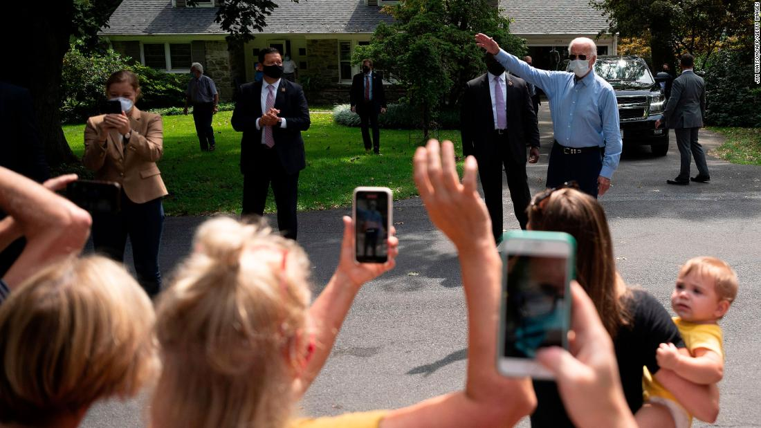 "Biden speaks to supporters from a distance after meeting with labor leaders in Lancaster, Pennsylvania, in September 2020. Because of the coronavirus pandemic, Biden has taken <a href=""https://www.cnn.com/2020/09/15/politics/gallery/trump-biden-2020-campaigns/index.html"" target=""_blank"">a careful approach to campaigning.</a>"