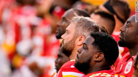 Kansas City Chiefs players stand for a presentation on social justice before an NFL football game against the Houston Texans Thursday, Sept. 10, 2020, in Kansas City, Mo.