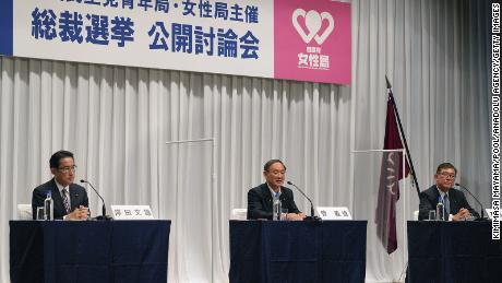 Japanese Chief Cabinet Secretary Yoshihide Suga (center) speaks during an online debate for the ruling Liberal Democratic Party's presidential election alongside former Foreign Minister Fumio Kishida (left) and former Defence Minister Shigeru Ishiba on Wednesday.