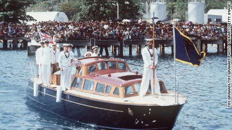 The Queen And Prince Philip arriving in Honiara on the Royal Barge on October 18, 1982.