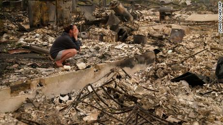"""Desiree Pierce cries as she visits her home destroyed by the Almeda Fire in Talent, Oregon, on Friday, Sept. 11, 2020. """"I just needed to see it, to get some closure,"""" she said."""