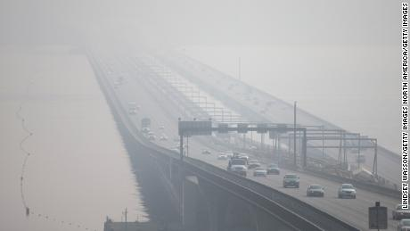 The Interstate 90 bridge over Lake Washington in Seattle disappears through heavy smoke from wildfires on Friday, September 11, 2020.