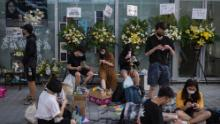 People fold paper cranes at the Hong Kong Design Institute as part of a memorial to Chan on October 17, 2019.