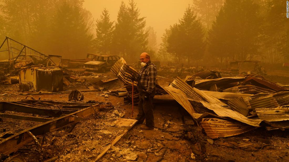 George Coble walks through his destroyed property in Mill City, Oregon, on September 12.